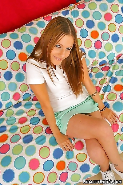 Lusty red haired teen babe..