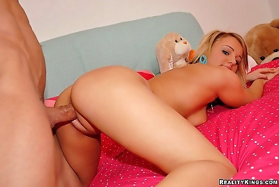 Sexy blonde rubs her pussy..