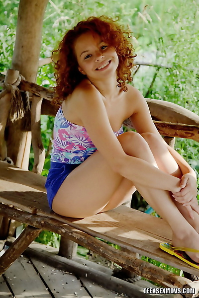 Young redhead removes shorts..