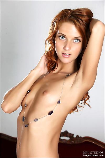 Thin redhead model shows off..